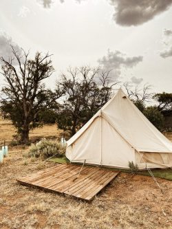 white tent on brown soil